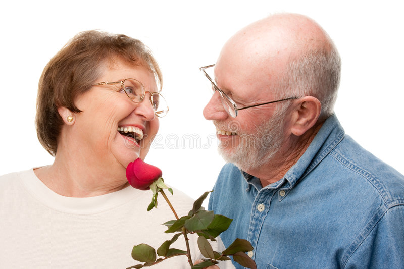 Happy Senior Couple with Red Rose. Isolated on a White Background stock images