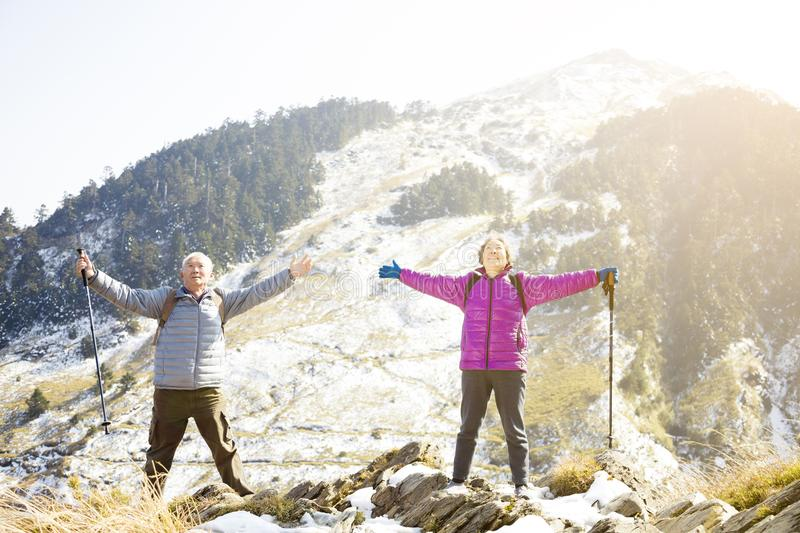 Senior couple relaxed on the mountain royalty free stock image