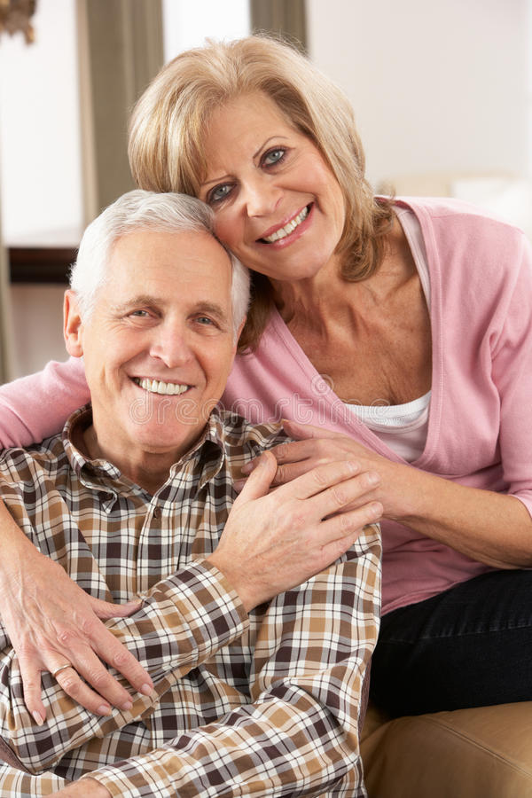 Happy Senior Couple Relaxing At Home stock images