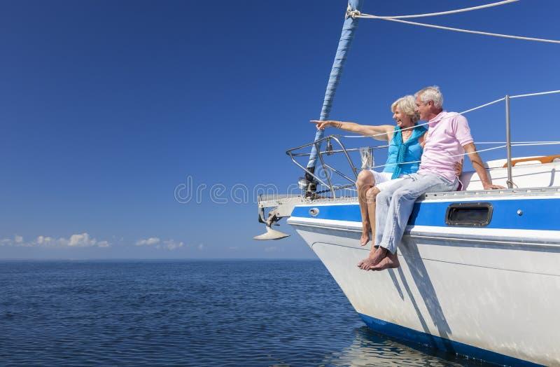 Happy Senior Couple Sailing on a Sail Boat royalty free stock image