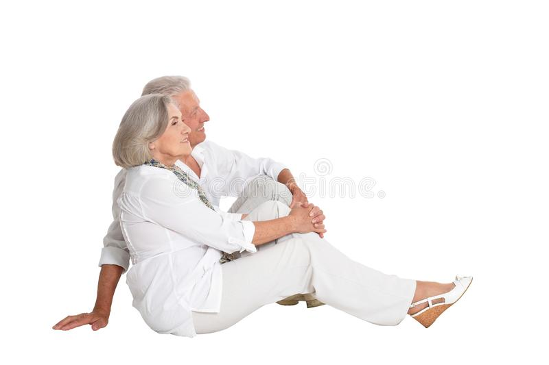Portrait of happy senior couple on white background stock images