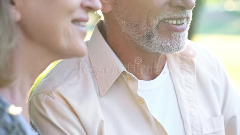 Happy senior couple smiling, healthy teeth, dental implants, prosthetics royalty free stock image