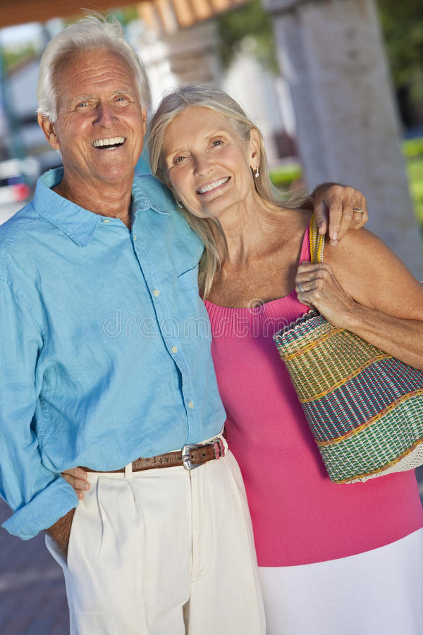 Download Happy Senior Couple Smiling Outside In Sunshine Stock Image - Image: 19259205