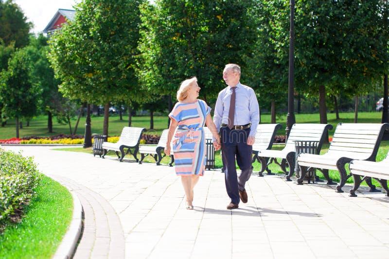 Happy senior couple in summer park stock photos