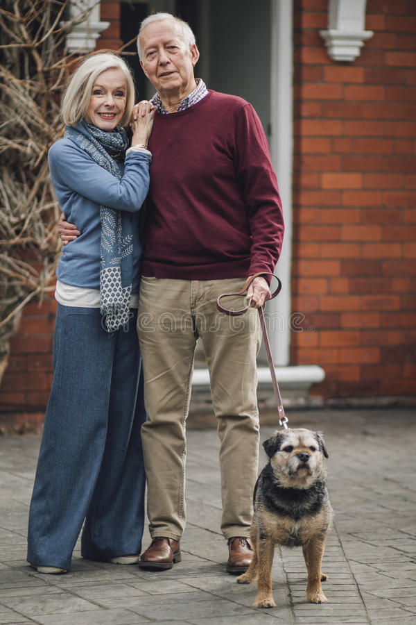 Happy Senior Couple With Their Dog stock photos