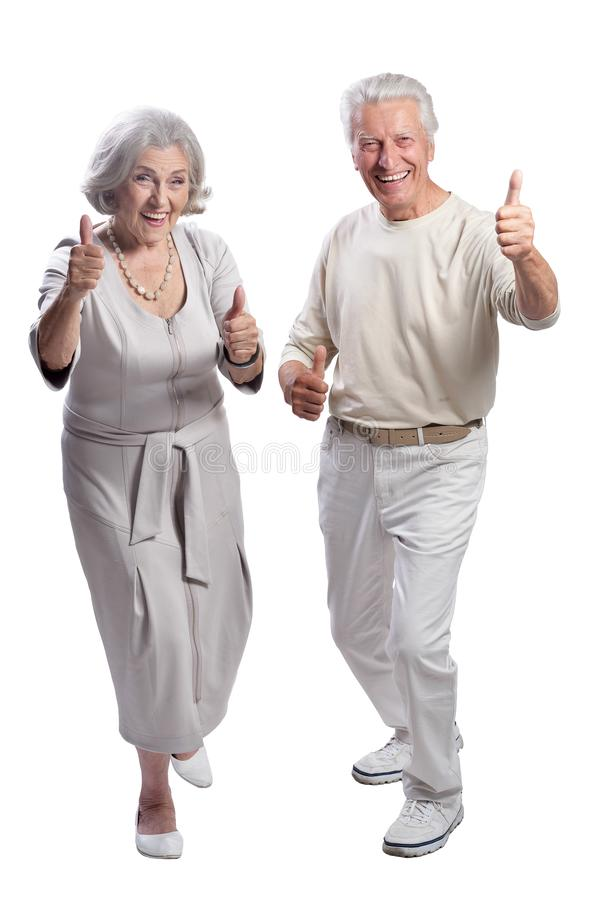 Happy senior couple with thumbs up on white background. Happy senior couple with thumbs up isolated on white background stock photography