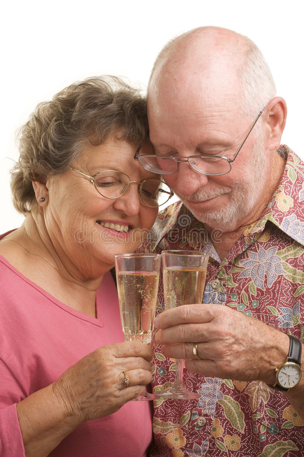 Happy Senior Couple Toasting. With Champagne glasses royalty free stock image