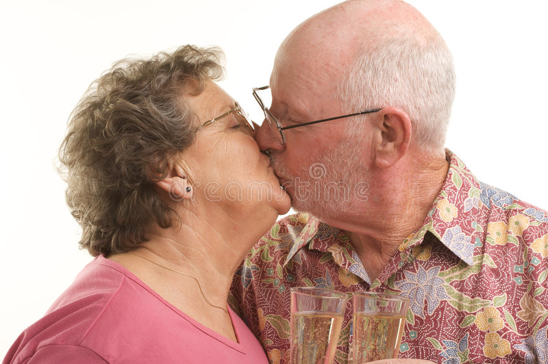Happy Senior Couple Toasting. Happy Senior Couple kiss with Champagne glasses stock photography