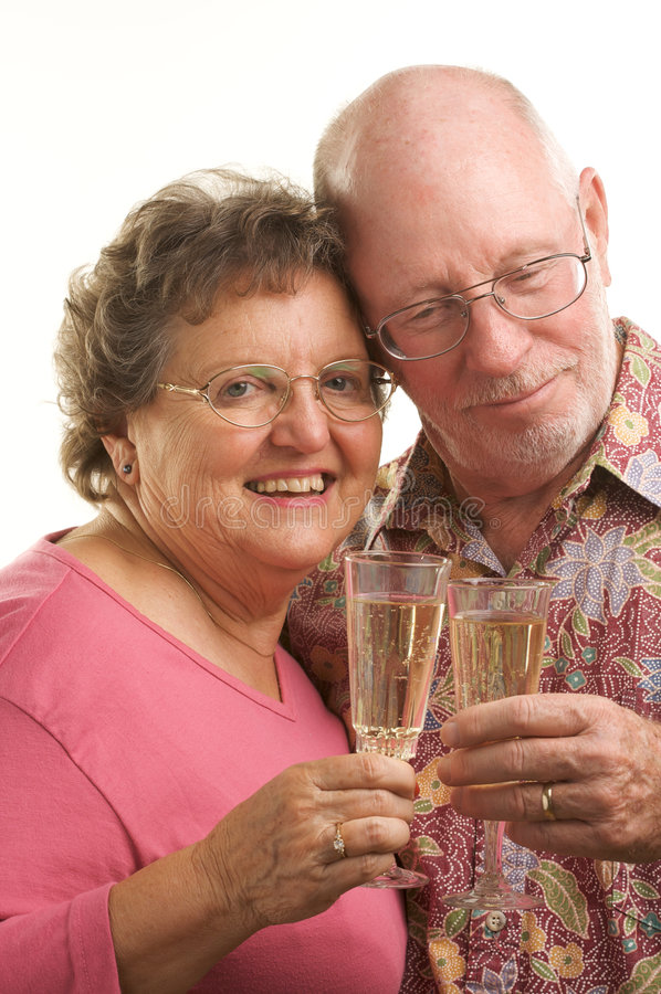 Happy Senior Couple Toasting. Happy Senior Couple toast with Champagne glasses royalty free stock images