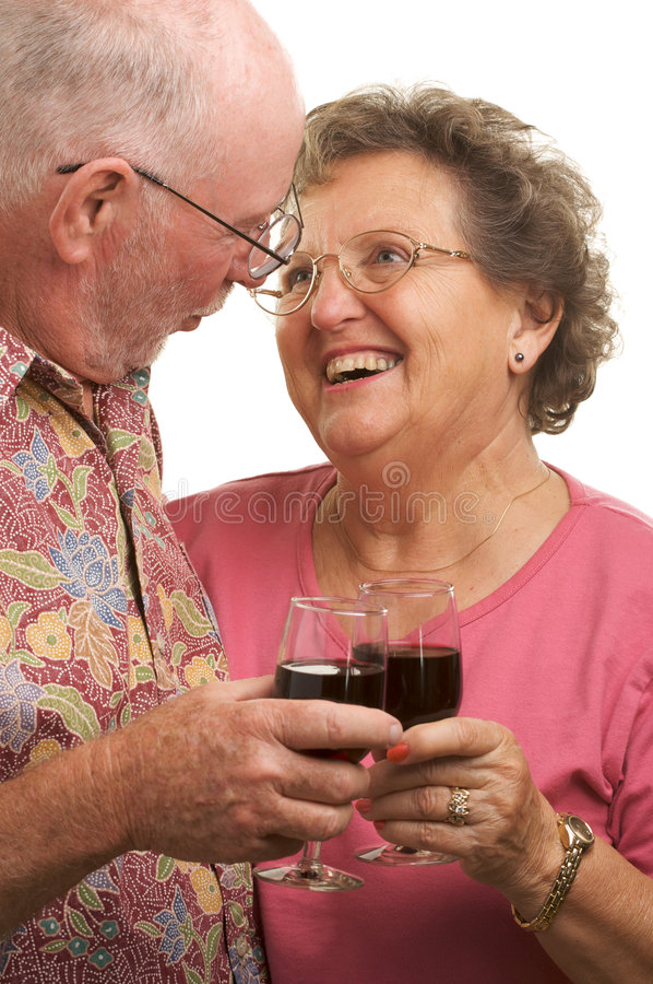 Happy Senior Couple Toasting. With Wine glasses royalty free stock images