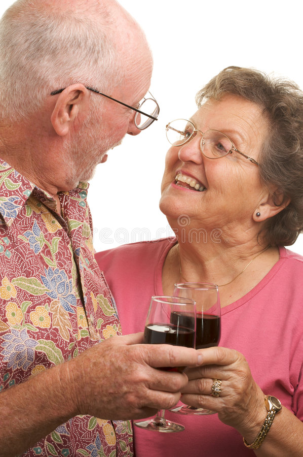 Happy Senior Couple Toasting. With Wine glasses royalty free stock photos