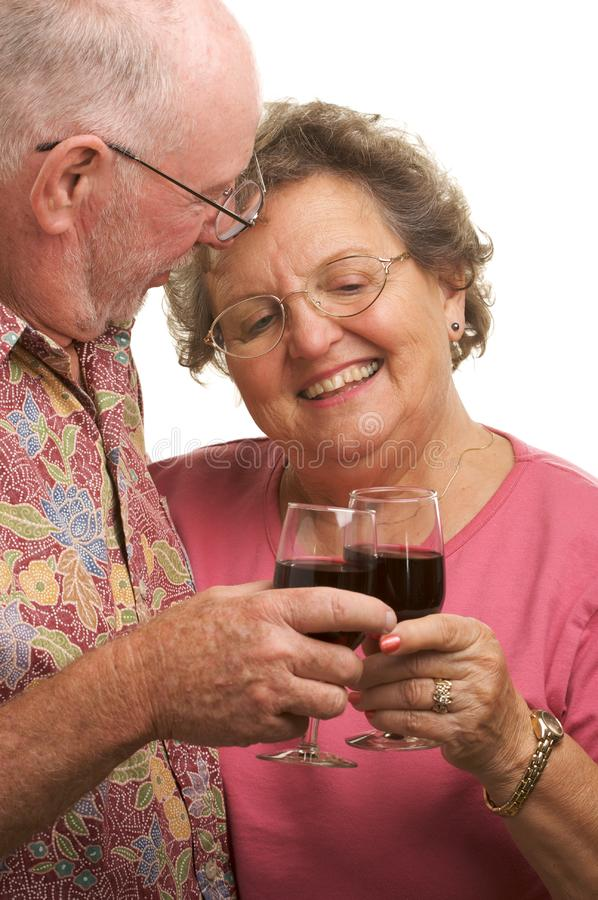 Happy Senior Couple Toasting stock image
