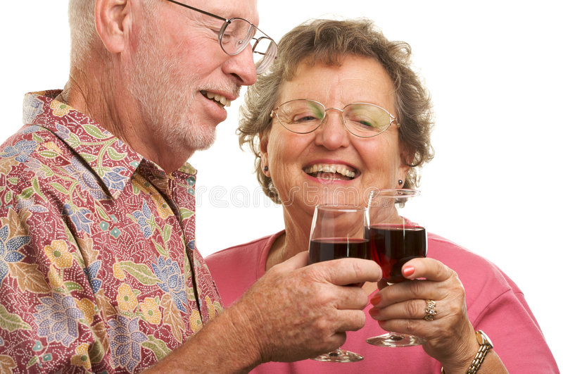 Happy Senior Couple Toasting. With Wine glasses stock images