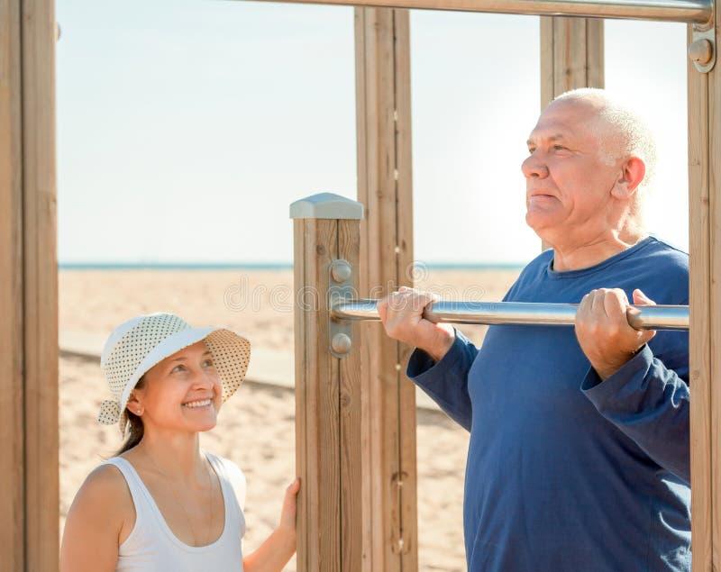 Download Happy Senior Couple Training On Pull-up Bar Stock Photo - Image: 43643002
