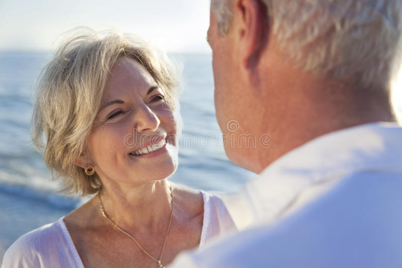 Happy Senior Couple on A Tropical Beach stock photo