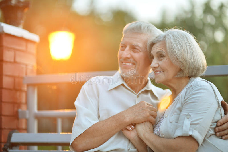 Happy senior couple on vacation. Portrait of happy senior couple on vacation stock images