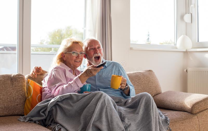 Senior couple watching tv stock photography