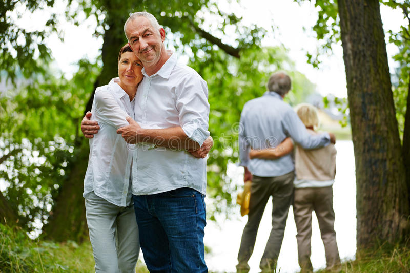 Happy senior couples in garden of retirement home royalty free stock photo
