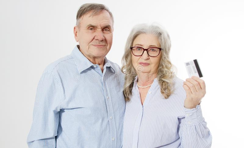 Happy senior family couple with credit card payment isolated on white background. Close up portrait woman and man with wrinkled royalty free stock photo