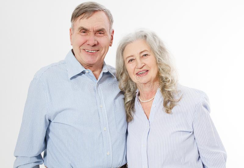 Happy senior family couple isolated on white background. Close up portrait woman and man with wrinkled face. Elderly grandparents royalty free stock images