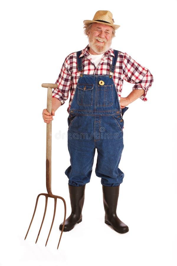 Free Happy Senior Farmer Holding Hay Fork Stock Photo - 23681850