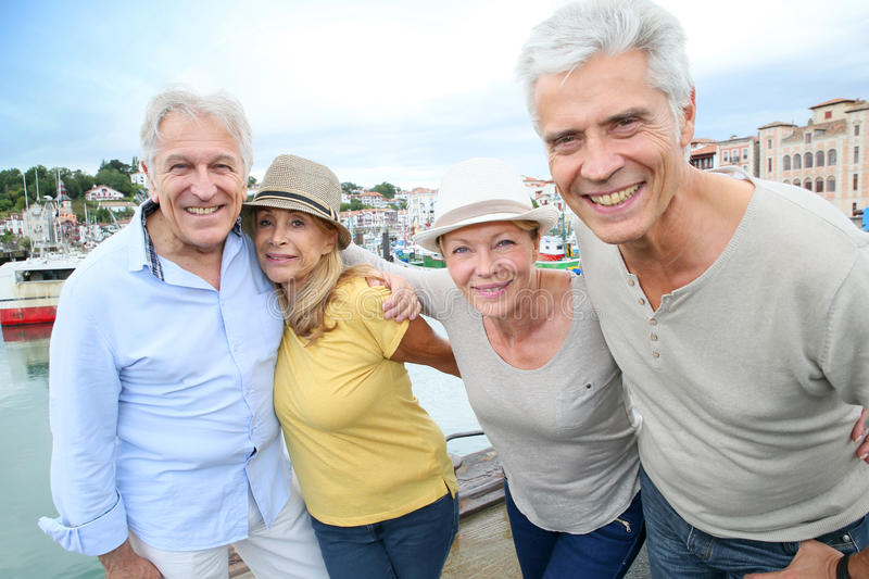 Happy senior friends on a visiting tour trip royalty free stock image