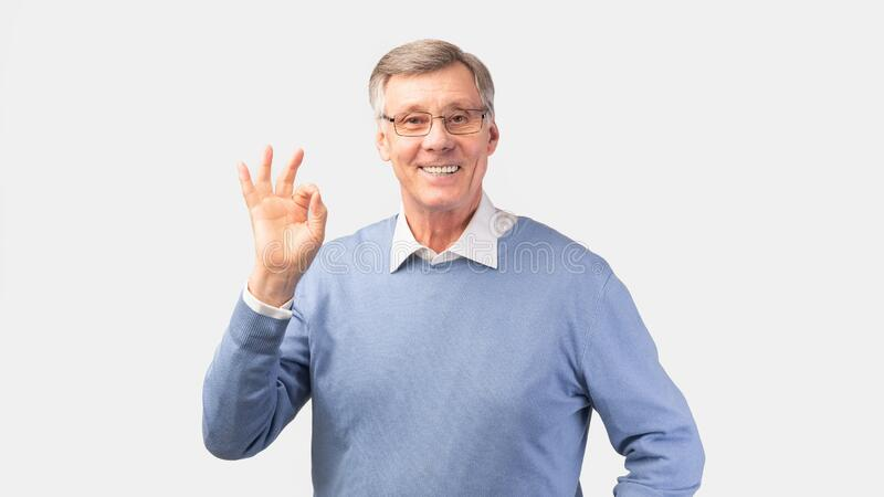 Happy Senior Gentleman Gesturing Okay Standing Over White Background, Panorama. Everything Is OK. Happy Senior Gentleman Gesturing Okay Sign Smiling To Camera stock images