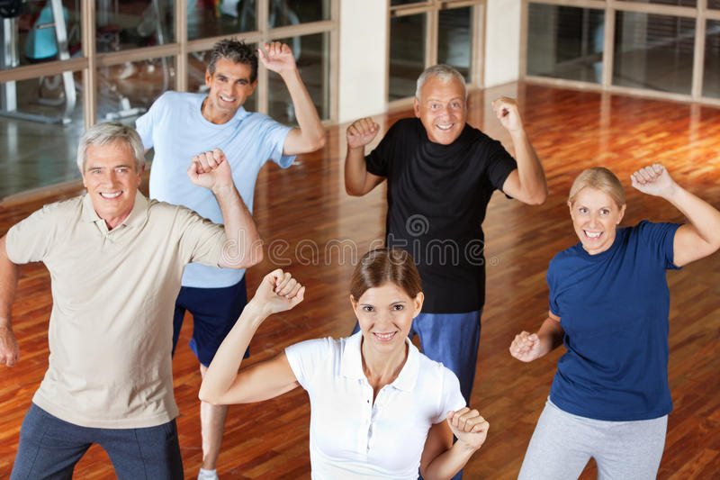 Happy senior group moving stock photos