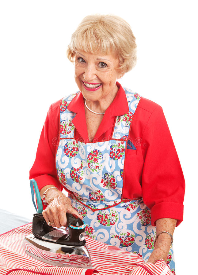 Happy Senior Ironing stock photography