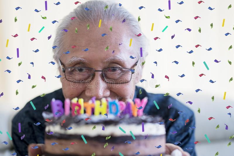 Happy senior man celebrating his birthday stock photos