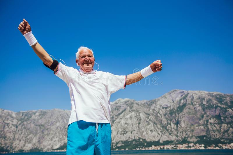 Senior man doing morning exercise at the beach royalty free stock photography