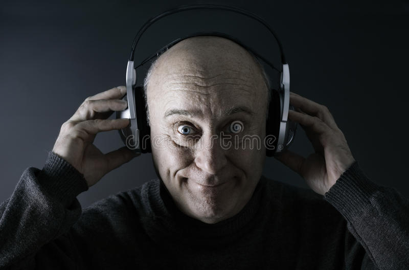 Happy Senior Man With Headsets Royalty Free Stock Images