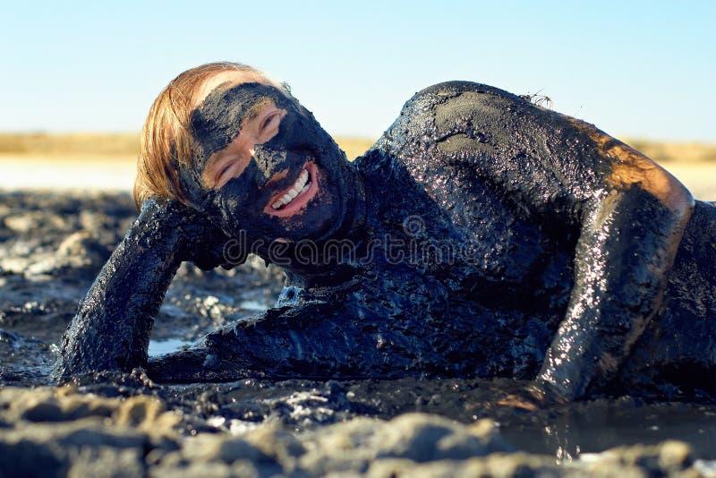 Download Happy Senior Man Lying In Healing Clay Stock Photo - Image: 24484108