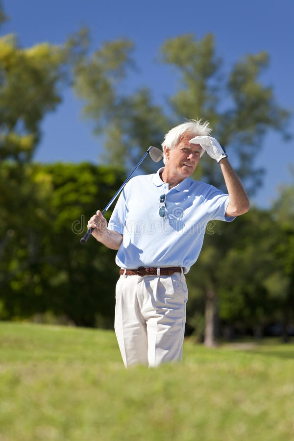 Happy Senior Man Playing Golf Looking For His Ball royalty free stock photography