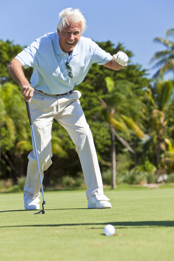 Happy Senior Man Putting Playing Golf royalty free stock photo