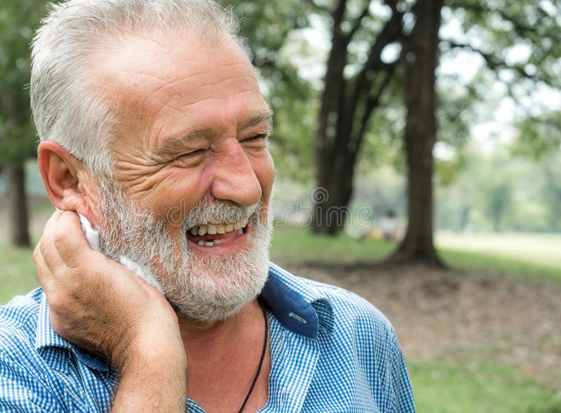Happy Senior man relax lifestyle in the park, Smiling happily on holiday, Happy life stock image
