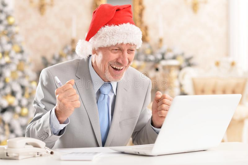 Portrait of senior man working with laptop royalty free stock photo