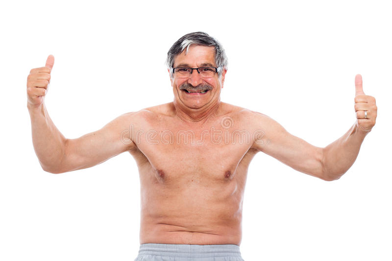 Happy senior man showing his body stock photography