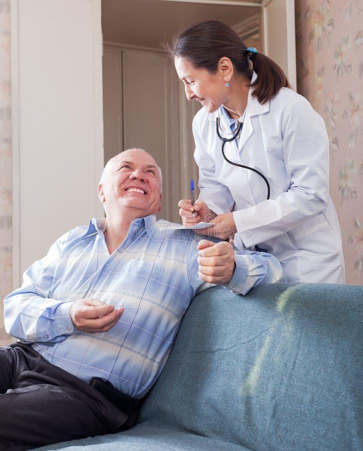 Happy senior man tells the doctor the symptoms royalty free stock image