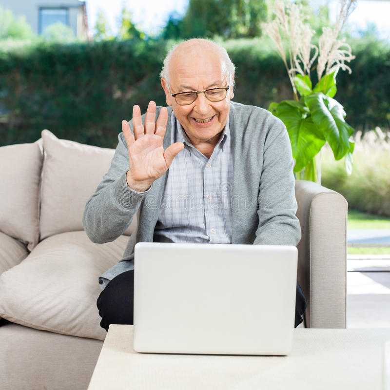 Happy Senior Man Video Chatting On Laptop royalty free stock images