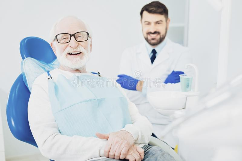 Happy senior man visiting dentist royalty free stock images