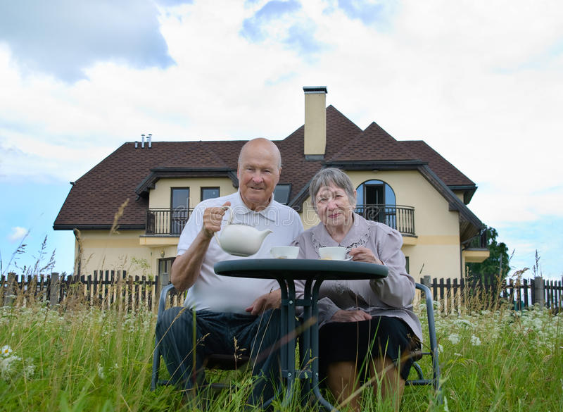 Happy senior man and woman stock photo