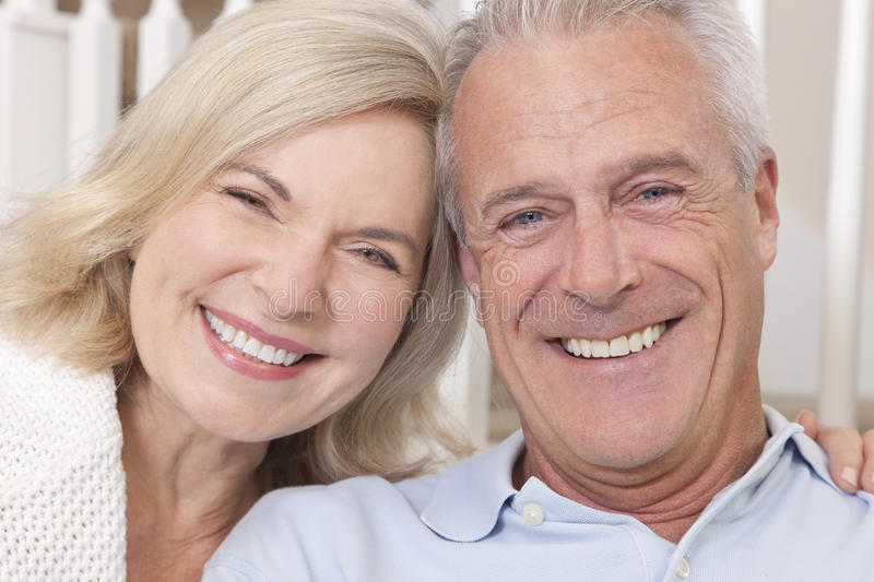 Happy Senior Man & Woman Couple Smiling at Home royalty free stock photography