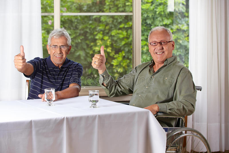 Happy senior men holding thumbs up royalty free stock image