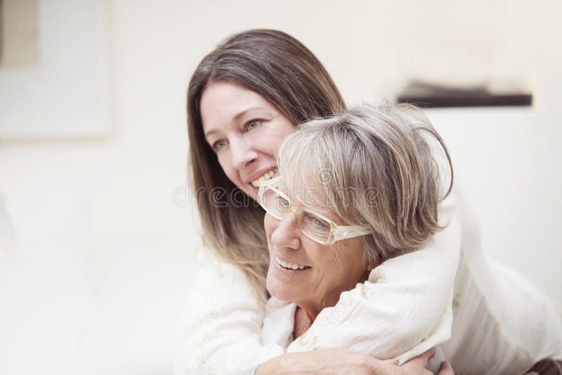 Happy senior mother and daughter stock photos