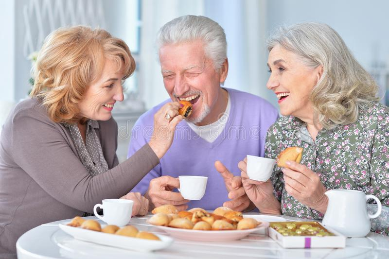 Portrait of happy senior people drinking tea royalty free stock images