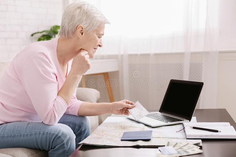 Senior woman looking planning travel with map stock images