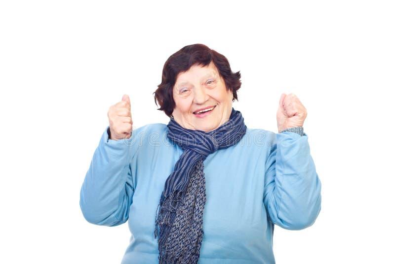 Happy senior woman cheering stock images