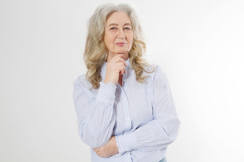 Happy senior woman with crossed arms isolated on white background. Positive elderly seniors life living and european old beauty royalty free stock photo