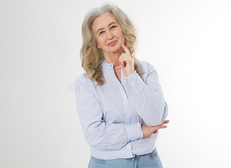 Happy senior woman with crossed arms isolated on white background. Positive elderly seniors life living and european old beauty stock images